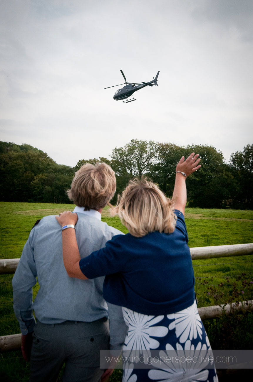 Waving to the wedding helicopter