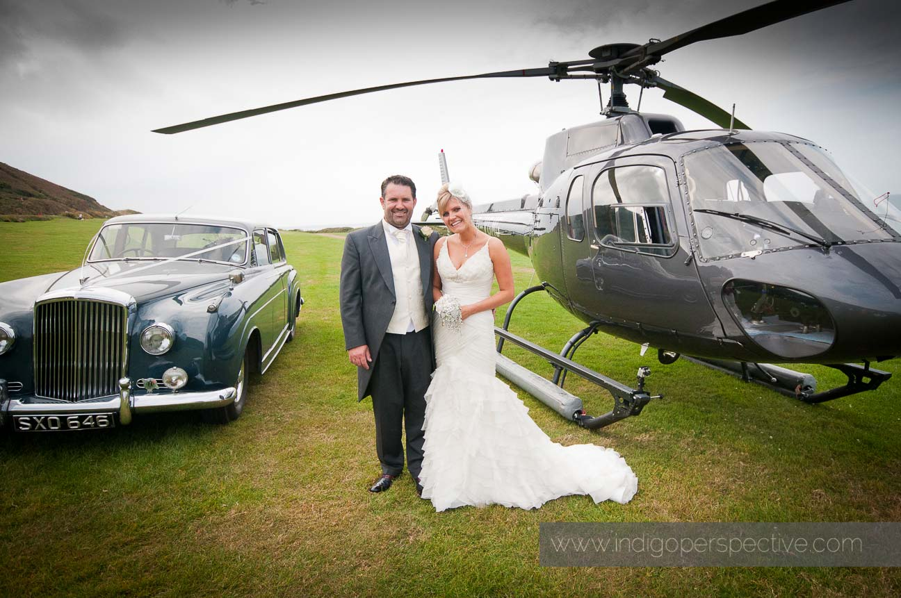 Bride & Groom with helicopter and car